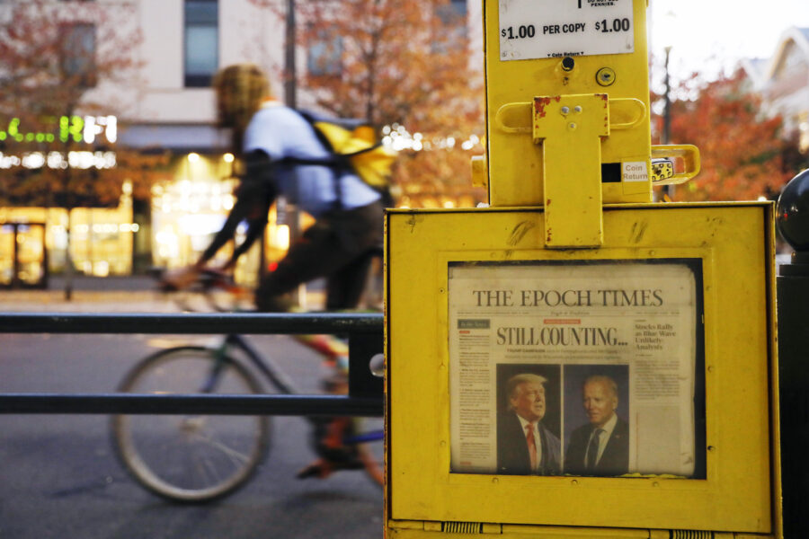 A newspaper from Thursday, Nov. 5 sits in a street box outside the Pennsylvania Convention Center in Philadelphia, where a handful of supporters of President Donald Trump continue to protest Monday, Nov. 9, 2020, two days after the election was called for Democrat Joe Biden. (AP Photo/Rebecca Blackwell)