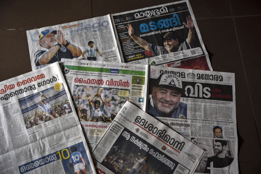 """Copies of Malayalam language newspapers that have the demise of Diego Maradona as the lead news are seen in Kochi, India, Thursday, Nov. 26, 2020. Maradona, the Argentine soccer great who scored the """"Hand of God"""" goal in 1986 and led his country to that year's World Cup title before later struggling with cocaine use and obesity, has died. He was 60. (AP Photo/R S Iyer)"""