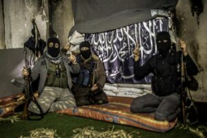 Members of al-Qaeda with covered face from different nationalities, they are in an area called the Air Force Intelligence in Aleppo fighting with al-Assad's army elements in the front  line. (Photo by Ibrahim Khader / Pacific Press) Lapresse Only italyMembri di al-Qaeda con il volto coperto ad Aleppo in Siria