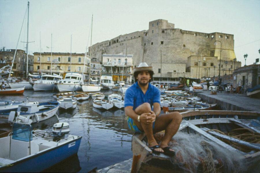 The Argentine footballer of Naples Diego Armando Maradona sitting on a boat at the marina of Borgo Marinaro. Naples, September 1986. (Photo by Barbara Rombi Serra/Mondadori Portfolio via Getty Images)
