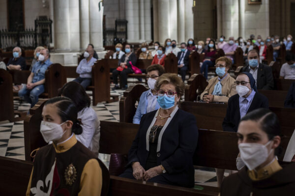 Catholic worshippers, wearing protective face masks as a measure to help curb the spread of the new coronavirus, attend a holy Corpus Christ mass inside the Almudena cathedral in Madrid, Spain, Sunday, June 14, 2020. (AP Photo/Bernat Armangue)