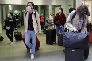 Travellers arrive from a Eurostar train at St Pancras Station in London, Friday, Aug. 14, 2020. People arriving in UK from France, the Netherlands, Monaco, Malta, Turks & Caicos and Aruba from 04:00 Saturday Aug.15 will need to self-isolate for two weeks as these countries are removed from the travel exemptions list. (AP Photo/Kirsty Wigglesworth)