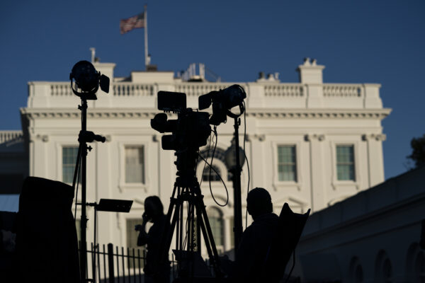 Journalists gather outside the White House, Wednesday, Nov. 4, 2020, in Washington. (AP Photo/Evan Vucci)