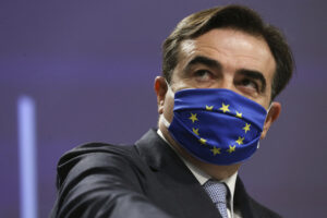 European Commission Vice-President Margaritis Schinas wears a protective face mask prior to speaking during a live streamed press conference at EU Headquarters in Brussels, Friday, Nov. 27, 2020. The EU chaired on Monday the 15th annual high-level meeting with religious leaders, gathering eight representatives of religious organizations from across Europe. (Francois Walschaerts, Pool via AP)