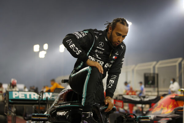 Mercedes driver Lewis Hamilton of Britain exits his car after wining the Formula One race in Bahrain International Circuit in Sakhir, Bahrain, Sunday, Nov. 29, 2020. (Hamad Mohammed, Pool via AP)