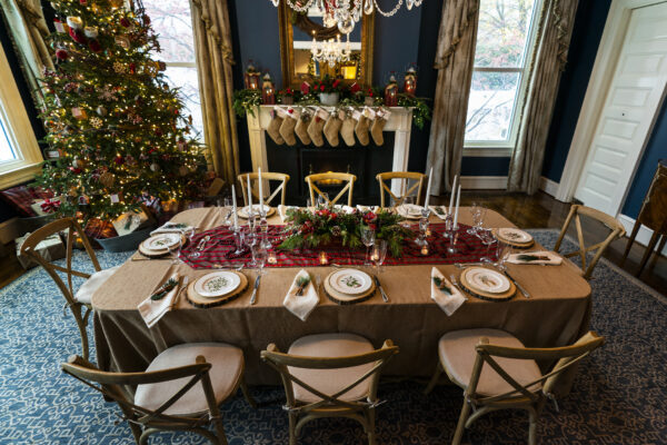 """The vice president's official residence dining room is decorated with a Christmas tree with stockings for the Pence family, including their pets, hanging on the mantle of the fireplace, Monday, Nov. 30, 2020 in Washington. The 2020 Christmas decorations theme """"Old Fashioned Christmas"""" was unveiled by Karen Pence the wife of the Vice President Mike Pence. (AP Photo/Manuel Balce Ceneta)"""