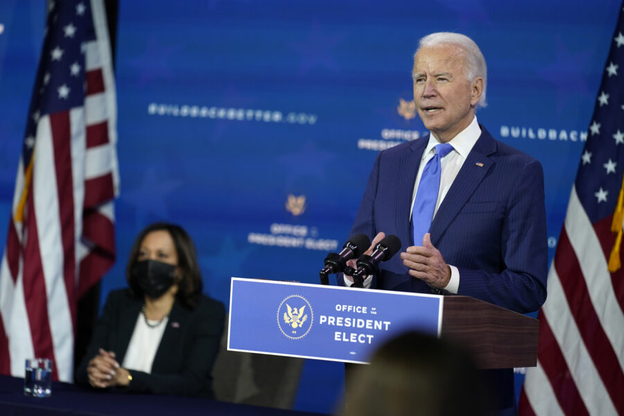 President-elect Joe Biden speaks as Vice President-elect Kamala Harris listens at left, during an event to introduce their nominees and appointees to economic policy posts at The Queen theater, Tuesday, Dec. 1, 2020, in Wilmington, Del. (AP Photo/Andrew Harnik)