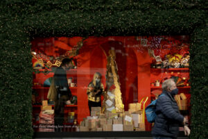 Staff arrange a window display before the Selfridges department opened for the day's trading as non-essential shops are allowed to reopen after England's second lockdown ended at midnight, on Oxford Street, in London, Wednesday, Dec. 2, 2020. (AP Photo/Matt Dunham)