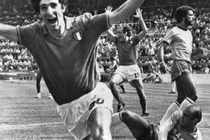FILE – In this July 5, 1982 file photo, Italy's Paolo Rossi, left, celebrates, after scoring the second goal for his team during their World Cup second round soccer match against Brazil, in Barcelona, Spain. Rossi died of Cancer, Dec. 10, 2020. He was 64. (AP Photo/File)