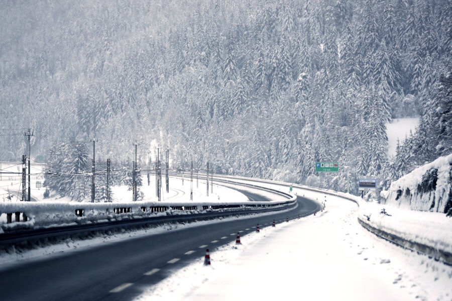 Snow covers trees at the deserted motorway A22 near the Austrian border in German speaking Italian province of South Tyrol in Brennero, northern Italy, Sunday, Dec. 13, 2020. (AP Photo/Matthias Schrader)