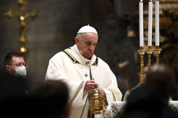Pope Francis celebrates Mass on Christmas eve, at St. Peter's basilica at the Vatican, Thursday, Dec. 24, 2020. (Vincenzo Pinto/Pool Photo via AP)