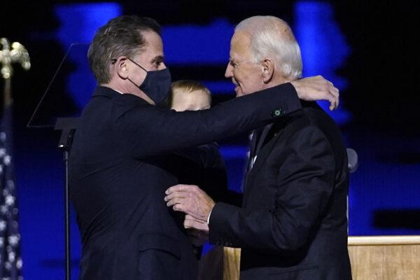 President-elect Joe Biden, right, embraces his son Hunter Biden, left, Saturday, Nov. 7, 2020, in Wilmington, Del. (AP Photo/Andrew Harnik, Pool)