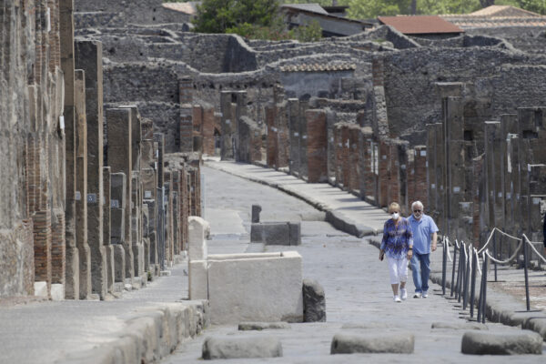 Colleen and Marvin Hewson, from the United States, visit to the archeological site of Pompeii, near Naples, southern Italy, Tuesday, May 26, 2020. The American couple waited a lifetime plus 2 ½ months to visit the ancient ruins of Pompeii together. For Colleen and Marvin Hewson, the visit to the ruins of an ancient city destroyed in A.D. 79 by a volcanic eruption was meant to be the highlight a trip to celebrate his 75th birthday and their 30th anniversary. They were among the only tourists present when the archaeological site reopened to the public on Tuesday after the national lockdown to prevent the spread of COVID-19.  (AP Photo/Alessandra Tarantino)
