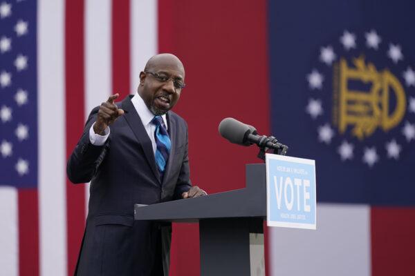 Georgia Democratic candidate for U.S. Senate Raphael Warnock speaks during a drive-in rally Tuesday, Dec. 15, 2020, in Atlanta. (AP Photo/Patrick Semansky)