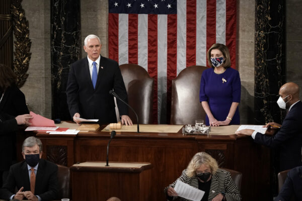 Speaker of the House Nancy Pelosi, D-Calif., and Vice President Mike Pence officiate as a joint session of the House and Senate convenes to confirm the Electoral College votes cast in November's election, at the Capitol in Washington, Wednesday, Jan. 6, 2021. (AP Photo/J. Scott Applewhite, Pool)
