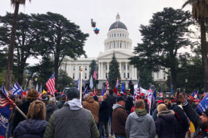 Hundreds of pro-Trump demonstraors gather outside the California Capitol building in Sacramento Wednesday, Jan. 6, 2021. Thousands of protesters nationwide are cheering President Donald Trump and his baseless claims of election fraud before Congress' vote to affirm President-elect Joe Biden's victory. (AP Photo/Adam Beam)