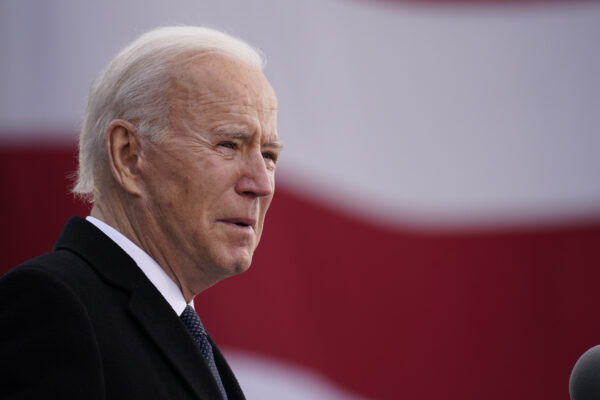 "President-elect Joe Biden speaks at the Major Joseph R. ""Beau"" Biden III National Guard/Reserve Center, Tuesday, Jan. 19, 2021, in New Castle, Del. (AP Photo/Evan Vucci)"