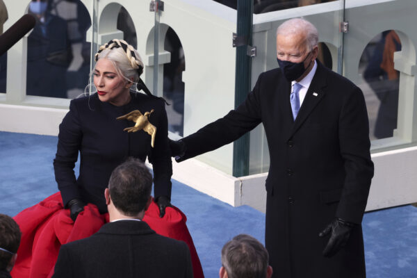 Lady Gaga reacts with President-elect Joe Biden after singing the National Anthem at Biden's inauguration on the West Front of the U.S. Capitol on Wednesday, Jan. 20, 2021 in Washington. ( Tasos Katopodis/Pool Photo via AP)
