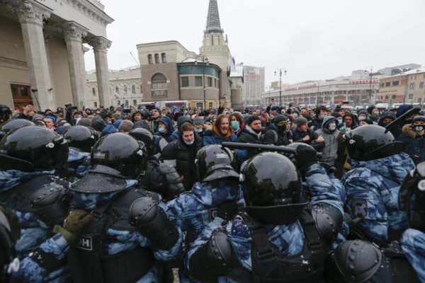 People clash with police during a protest against the jailing of opposition leader Alexei Navalny in Moscow, Russia, Sunday, Jan. 31, 2021. Thousands of people took to the streets Sunday across Russia to demand the release of jailed opposition leader Alexei Navalny, keeping up the wave of nationwide protests that have rattled the Kremlin. Hundreds were detained by police. (AP Photo/Alexander Zemlianichenko) People clash with police during a protest  against the jailing of opposition leader Alexei Navalny in Moscow, Russia, on Sunday, Jan. 31, 2021. Thousands of people took to the streets Sunday across Russia to demand the release of jailed opposition leader Alexei Navalny, keeping up the wave of nationwide protests that have rattled the Kremlin. Hundreds were detained by police. (AP Photo/Alexander Zemlianichenko)