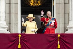 "HRH Queen Elisabeth the 2nd & Prince Philip, The Duke of Edinburgh waves to the crowds from the balcony of Buckingham Palace   Since 1748 Trooping the Colour has also marked the official birthday of the British sovereign. It is held in London annually on a Saturday in June on Horse Guards Parade next to St. James's Park, and coincides with the publication of the Birthday Honours List. Among the audience are the Royal Family, invited guests, ticketholders and the general public. The colourful ceremony is also known as ""The Queen's Birthday Parade"", though the official birthday for the Queen is on the 21st of June"