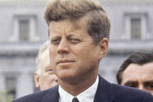 FILE – In this April 30, 1963 file photo, President John F. Kennedy listens while Grand Duchess Charlotte of Luxembourg speaks outside the White House in Washington. The National Archives has until Oct. 26, 2017, to disclose the remaining files related to Kennedy's Nov. 22, 1963 assassination, unless President Donald Trump intervenes. (AP Photo/William J. Smith, File)