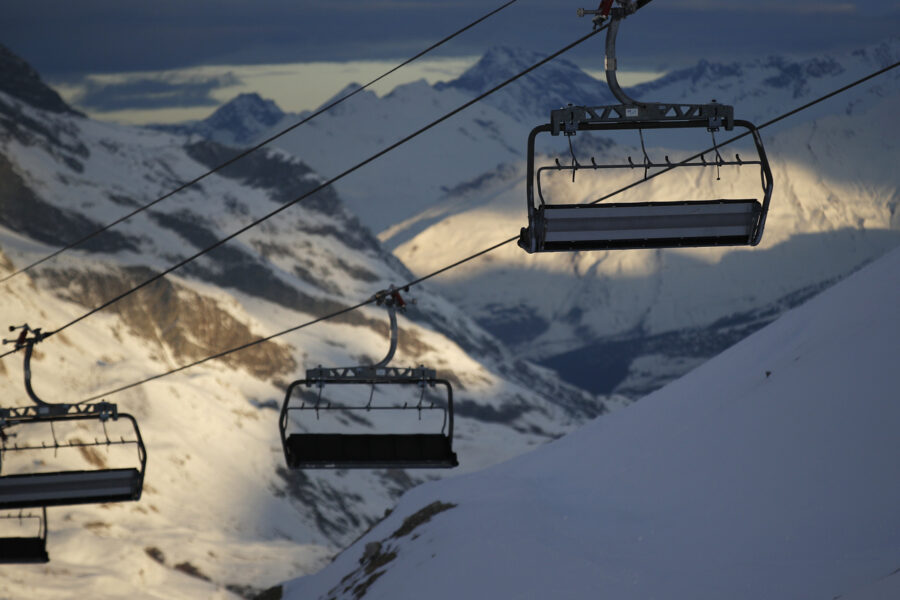 Chairlifts are stopped as several European countries have suspended access to the ski slopes to stop the spread of the COVID-19 pandemic, in the ski resort of Val d'Isere, France, Friday, Dec. 18, 2020. (AP Photo/Gabriele Facciotti)