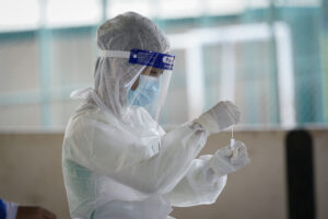 A medical worker collects a swab test sample during a coronavirus testing at a center for private COVID-19 testing in Petaling Jaya, Malaysia, on Monday, Feb. 1, 2021. Malaysian authorities imposed tighter restrictions on movement to try to halt the spread of the coronavirus. (AP Photo/Vincent Thian)