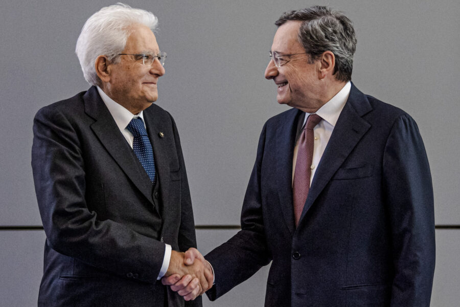 FILE– Italy's President Sergio Mattarella, left, welcomes reigning European Central Bank President Mario Draghi on the eve of the change at the head of the ECB in Frankfurt, Germany, Monday, Oct. 28, 2019. Italian President Sergio Mattarella has summoned Tuesday, Feb. 2, 2021, former European Central Bank President Mario Draghi at the Quirinale Presidential Palace on Wednesday for talks, after two rounds of talks failed to seal an agreement among parties on a new premiership for the outgoing Giuseppe Conte. (Boris Roessler/Pool Photo via AP)