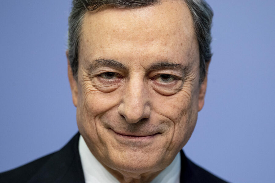 FILE– President of European Central Bank Mario Draghi looks on prior to a press conference following a meeting of the governing council in Frankfurt, Germany, Thursday, July 25, 2019. Italian President Sergio Mattarella has summoned Tuesday, Feb. 2, 2021, former European Central Bank President Mario Draghi at the Quirinale Presidential Palace on Wednesday for talks, after two rounds of talks failed to seal an agreement among parties on a new premiership for the outgoing Giuseppe Conte. (AP Photo/Michael Probst)