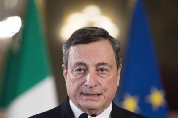 Former European Central Bank president Mario Draghi speaks to the media after accepting a mandate to form Italy's new government from Italian President Sergio Mattarella at the Rome's Quirinale Presidential Palace, Wednesday Feb. 3, 2021. (AP Photo/Alessandra Tarantino, Pool)
