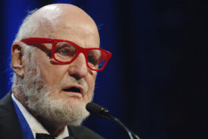 FILE – Author Lawrence Ferlinghetti recites a poem after he was awarded the Literarian Award for Outstanding Service to the American Literary Community at the National Book Awards in New York, on Nov. 16, 2005. Ferlinghetti, a poet, publisher and bookseller has died in San Francisco at age 101. His son says Ferlinghetti died at home on Monday, Feb. 22, 2021. Ferlinghetti helped launch and perpetuate the Beat movement. He was known for his City Lights bookstore in San Francisco, an essential meeting place for the Beats and other bohemians in the 1950s and beyond. (AP Photo/Henny Ray Abrams, File)