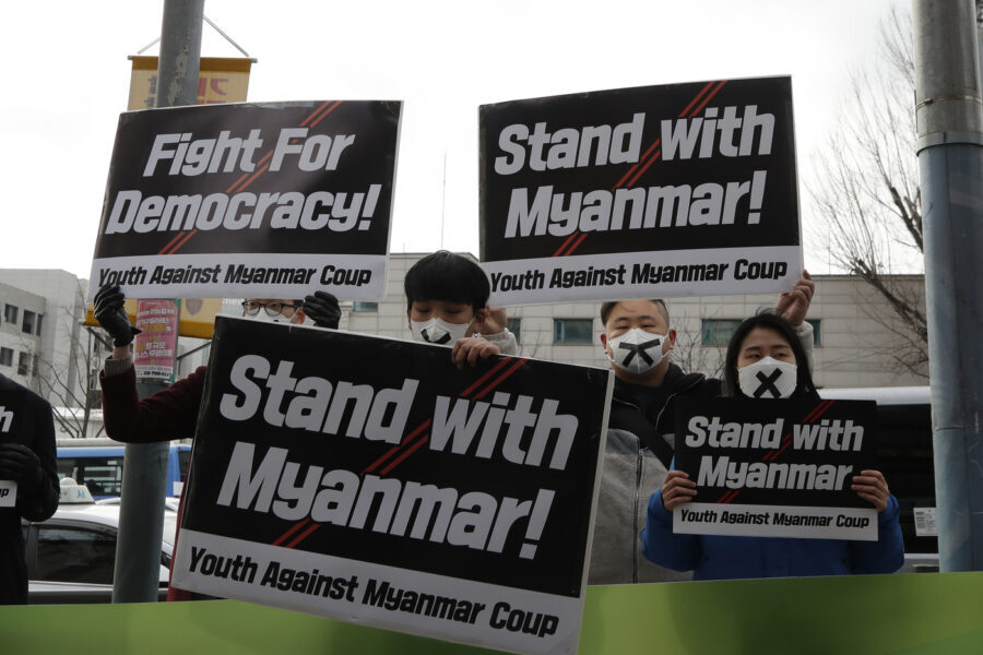 Members of youth group hold signs during a rally against the military coup and supporting Myanmar's democracy near the Myanmar embassy in Seoul, South Korea, Friday, Feb. 5, 2021. (AP Photo/Lee Jin-man)