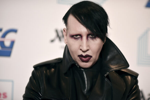 "FILE – Marilyn Manson attends the 9th annual ""Home for the Holidays"" benefit concert on Dec. 10, 2019, in Los Angeles. Manson was dropped by his record label Monday after his ex-fiancé, the actor Evan Rachel Wood, accused him of sexual and other physical abuse. (Photo by Richard Shotwell/Invision/AP, File)"