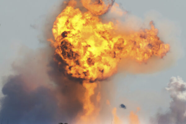 SpaceX's bullet-shaped Starship prototype explodes after crashing while attempting to land following a successful test launch, Tuesday, Feb. 2, 2021, in Boca Chica, Texas. (Miguel Roberts/The Brownsville Herald via AP)