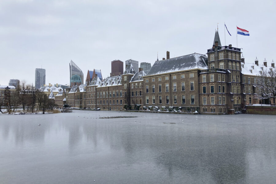 The frozen Hofvijver pond is seen outside the Dutch parliament buildings in The Hague, Netherlands, Tuesday, Feb. 9, 2021. With freezing temperatures forecast for more than a week in the Netherlands, ice fever is sweeping the nation, offering a welcome respite from grim coronavirus news while also creating a challenge for authorities trying to uphold social distancing measures. (AP Photo/Mike Corder)