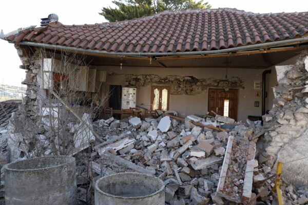A damaged house is seen after an earthquake in Damasi village, central Greece, Thursday, March 4, 2021. Fearful of returning to their homes, thousands of people in central Greece spent the night outdoors after a powerful earthquake, felt across the region, damaged homes and public buildings. (AP Photo/Vaggelis Kousioras)