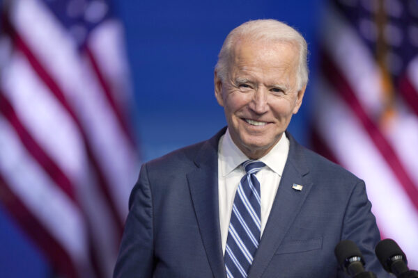President-elect Joe Biden pauses to smile as listens to media questions at The Queen theater, Tuesday, Nov. 10, 2020, in Wilmington, Del. (AP Photo/Carolyn Kaster)