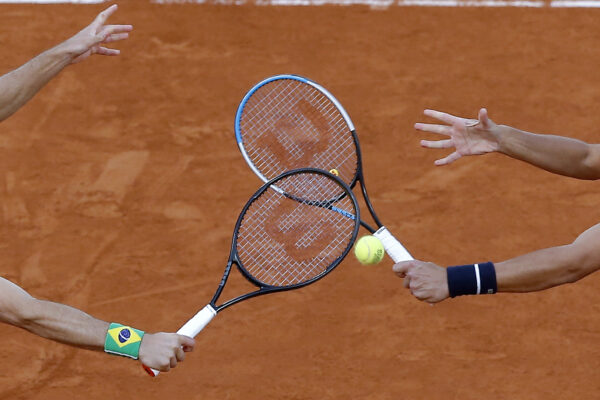 FILE – In this file photo dated Saturday, Oct. 10, 2020, Croatia's Mate Pavic, right, and Brazil's Bruno Soares play a shot in the men's doubles final match of the French Open tennis tournament at the Roland Garros stadium in Paris, France. The 2021 French Open schedule is being disrupted by the coronavirus pandemic for the second year in a row, as organizers said Thursday April 8, 2021, the Grand Slam tournament will be delayed by one week because of surging virus cases in France.(AP Photo/Michel Euler, FILE)