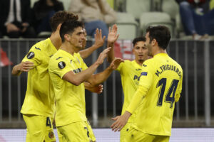 Villareal's Gerard Moreno celebrates after scoring his side's first goal during the Europa League final soccer match between Manchester United and Villarreal in Gdansk, Poland, Wednesday May 26, 2021. (Kacper Pempel, Pool via AP)