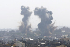 Smoke rises after an Israeli forces strike in Gaza in Gaza City, Tuesday, May 11, 2021. (AP Photo/Hatem Moussa)