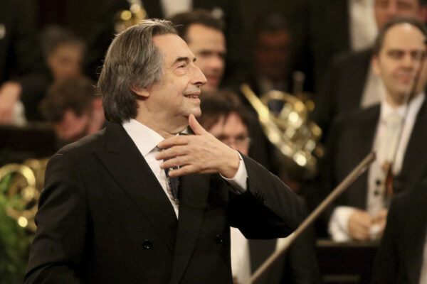 FILE – In this Jan. 1, 2018 file photo, Italian Maestro Riccardo Muti conducts the Vienna Philharmonic Orchestra during the traditional New Year's concert at the golden hall of Vienna's Musikverein, Austria.   Riccardo Muti, during a concert hje held at the Ravenna Festival, Sunday, June 21, 2020, has sent a resounding message that live classical music has returned the Italian stage after the coronavirus lockdown with a full summer festival program in his adopted Ravenna. (AP Photo/Ronald Zak, File)