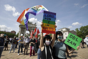 """A woman holds a banner reading in Italian """"Hate is not a right"""" during a demonstration to support a law proposal implementing prison punishment for those who commit crimes of discrimination based on sex, sex orientation, gender, gender identity, disability, in Milan, Italy, Saturday, May 8, 2021. The so-called Zan Law, named for a Democratic Party lawmaker and gay rights activist Alessandro Zan, would add women along with people who are gay, transgender or have disabilities to the classes of those already protected under a law banning discrimination and punishing hate crimes.(AP Photo/Luca Bruno)"""
