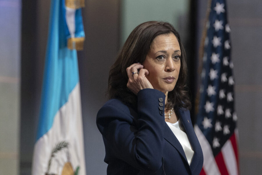 Vice President Kamala Harris removes her translation device during a news conference with Guatemalan President Alejandro Giammattei, Monday, June 7, 2021, at the National Palace in Guatemala City. (AP Photo/Jacquelyn Martin)