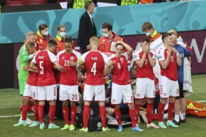 Denmark's players react as their teammate Christian Eriksen lays on the ground during the Euro 2020 soccer championship group B match between Denmark and Finland at Parken stadium in Copenhagen, Denmark, Saturday, June 12, 2021. (Wolfgang Rattay/Pool via AP)