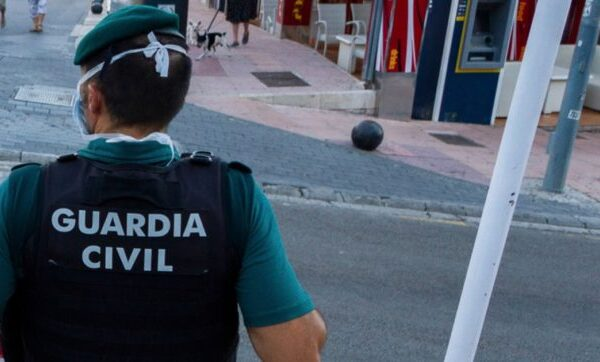 Guardia Civil officers patrol on the street at the resort of Magaluf, in Punta Ballena town, on the Spanish Balearic island of Mallorca, Spain, Wednesday, July 15, 2020. Authorities in Spain's Balearic Islands are pulling the plug on endless drunken nights to the beat of techno music by closing bars and nightclubs in beachfront areas popular with young and foreign visitors. (AP Photo/Francisco Ubilla)