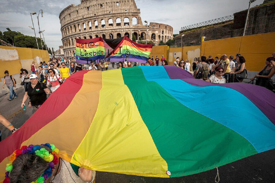 Participants carry a giant rainbow flag, a symbol of the gay rights movement, as they take part in the 22nd annual Gay Pride Parade in Rome, Italy on June 11, 2016. Tens of thousands of members of Italian LGBTQI (Lesbian, Gay, Bisexual, Transgender, Queer and Intersex) communities and supporters of gay rights take part in the annual Gay Pride Parade in downtown Rome to demand legal rights for same-sex couples and against homophobia.(Photo by Giuseppe Ciccia/NurPhoto via Getty Images)