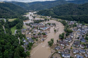 The Ahr river floats past destroyed houses in Insul, Germany, Thursday, July 15, 2021. Due to heavy rain falls the Ahr river dramatically went over the banks the evening before. (AP Photo/Michael Probst)