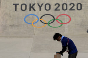 A worker prepares a rail at the skateboarding venue as preparations continue for the 2020 Summer Olympics, Tuesday, July 20, 2021, at the Ariake Urban Sports Park in Tokyo. (AP Photo/Charlie Riedel)