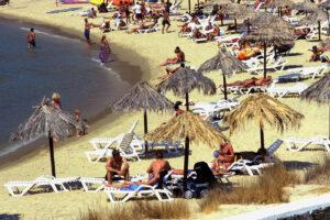 GREECE. CICLADI.  IOS MYLOPOTAS. UMBRELLAS ON THE BEACH