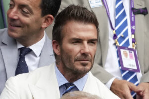 Former soccer star David Beckham waits for the men's singles semifinals match to begin on day eleven of the Wimbledon Tennis Championships in London, Friday, July 9, 2021. (AP Photo/Alberto Pezzali)